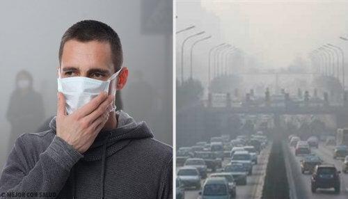 Hombre usando mascarilla por culpa de la contaminación del ambiente