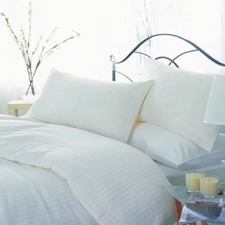 A bed with comfortable pillows.