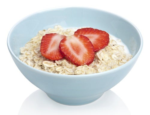 A bowl of oats and strawberries.