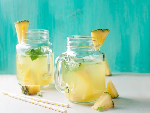 Two glasses of pineapple juice.