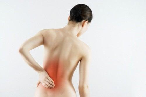 Dolor lumbar en la espalda.