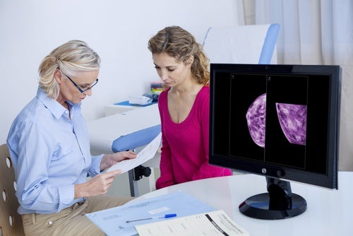 A specialist explaining mammogram results.