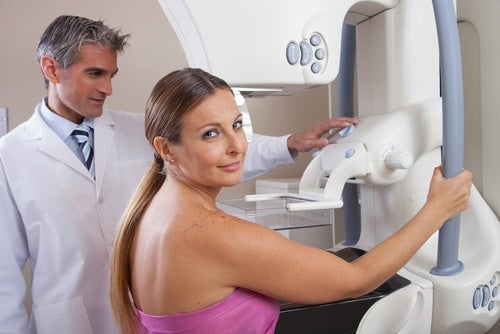 Woman about to have a mammogram.