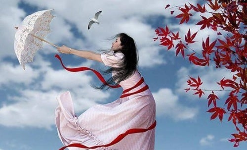 mujer-sujetandos-su-paraguas