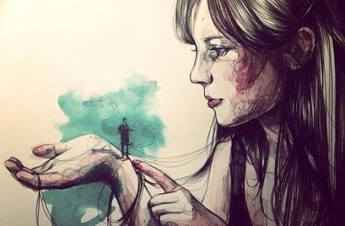 mujer-con-hombre-diminuto-en-la-mano pensando en esperar