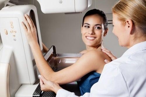 A woman having a mammogram.
