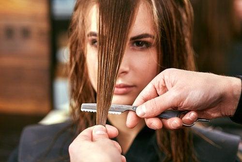 A woman getting a haircut.