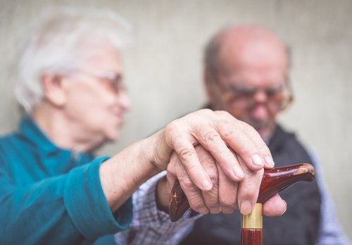 An elderly couple close together.