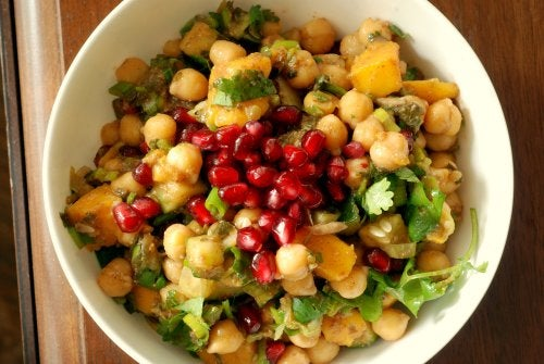 A bowl of chickpea, mango and pomegranate salad