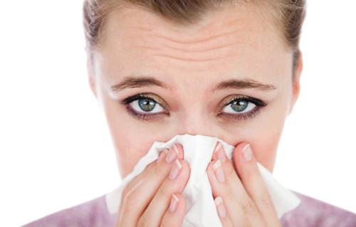 Woman suffering from allergic rhinitis