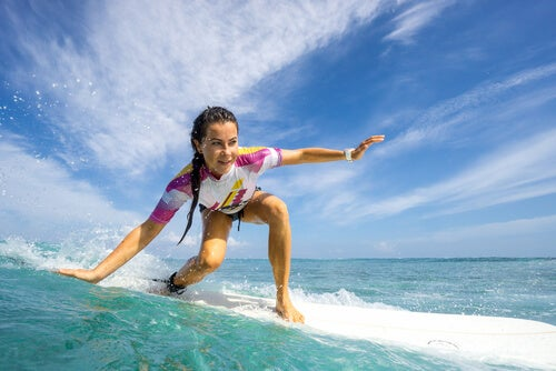 A woman surfing.