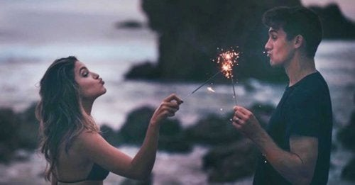 A couple with some sparklers.
