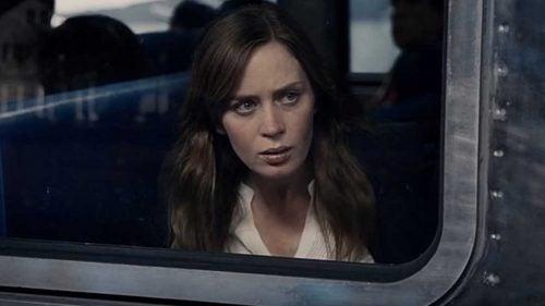 chica-mirando-a-través-de-la-ventana-del-tren