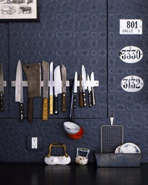 Using a magnetic bar in the kitchen to store knifes and keep your house organized