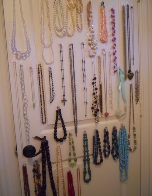 Using adhesive hooks for your jewelry to keep your house organized