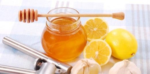 Jarra de miel y limones