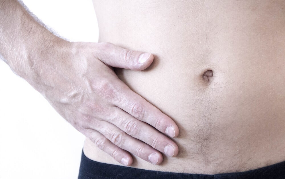 Dolor en el costado por hernia abdominal.